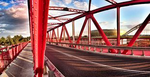 Red bridge. Artistic look in vintage vivid colours. Red bridge in Gdansk, way to the Baltic Arena, soccer, football Stadium in Gdansk, Poland Stock Photo