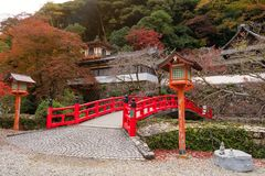 Autumn at Minoo Takianji temple, Osaka. Red bridge with Autumn foliage colors at Minoo Takianji temple in Osaka, Japan. Here, near Minoh waterfall, is famous Stock Photography