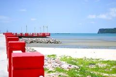 Red bridge and beach Stock Photos