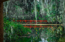 Red Bridge. Beautiful Red Bridge in the Magnolia Plantation and Gardens, South Carolina Royalty Free Stock Photography