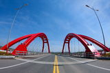 Red bridge. A beautiful red bridge under the blue sky Royalty Free Stock Images
