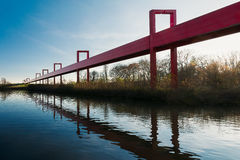 The red bridge on a blue sky background Royalty Free Stock Images