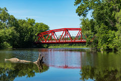 Red Bridge in bright daylight over the Wallkill River. Stock Photos