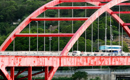 Red bridge with cars Royalty Free Stock Image