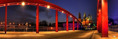 Red bridge and cathedral in the night Stock Photos