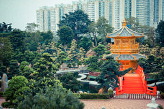 Red bridge and Chinese golden pavilion. Red bridge and golden pavilion in Chinese temple , Hongkong Royalty Free Stock Photo