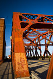 Red bridge constructions in the future and bright sky Stock Image