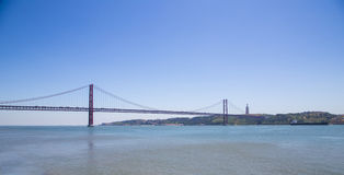 Red bridge and Cristo Rei, statue of Jesus, Lisbon, Portugal Royalty Free Stock Photos