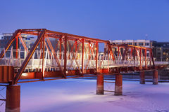 Red bridge in Des Moines. Red bridge in over Des Moines River. Des Moines, Iowa, USA Royalty Free Stock Photos