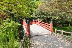 Red bridge of former Takaoka Castle, Takaoka, Japan Royalty Free Stock Photo