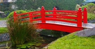Red bridge in garden Stock Photo