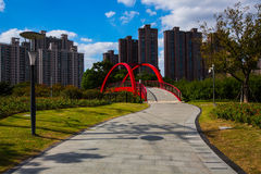 Red bridge in Greenland beside Gubei Road Bridge in Shanghai Stock Photography