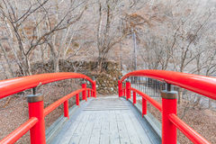 A red bridge in Ikaho Onsen on autumn is a hot spring town located on the eastern slopes of Mount Haruna , famous place of Gun. Ma Prefecture,Japan stock photo