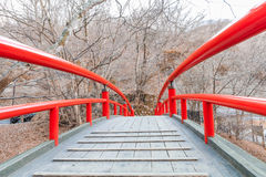 A red bridge in Ikaho Onsen on autumn is a hot spring town located on the eastern slopes of Mount Haruna , famous place of Gun. Ma Prefecture,Japan stock photography