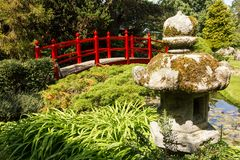 Red bridge. Irish National Stud's Japanese Gardens. Kildare. Ireland. A Red bridge. The Japanese Garden in the Japanese Gardens & Irish National Stud of Kildare stock photo