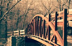 Red bridge at Jacobsburg State Park, Pennsylvania. Red bridge jacobsburg state park pennsylvania footbridge walk steel iron nature cold trees winter fall autumn stock photos