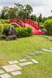 Red Bridge in a Japanese Garden. Small red bridge in a Japanese garden royalty free stock photography