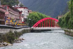 The red bridge of Kangding city in local market. Royalty Free Stock Images