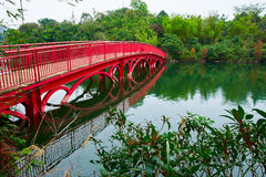 The red bridge and lake. The photo was taken in Grand Canyon scenic spot Shenzhen city Guangdong province, China Royalty Free Stock Photos