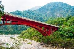 Red bridge locate in Taroko National Park landscape. Taiwan Stock Photo