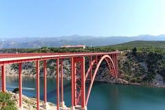 Red bridge. Modern steel structure red Maslenica Bridge Croatia royalty free stock photo