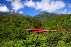 Red bridge with mountain Royalty Free Stock Images
