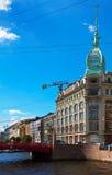 Red Bridge through Moyka River in Saint Petersburg Royalty Free Stock Photos