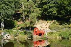 Red bridge in Oriental Park Royalty Free Stock Images