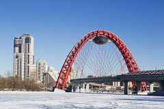 Red bridge over the frozen Moskva river, Moscow Stock Photography