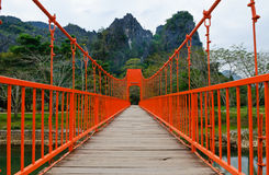 Red bridge over song river, vang vieng, laos. Red bridge across song river, vang vieng, laos stock photography
