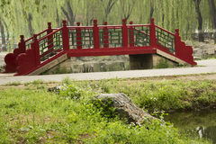 Red Bridge. In the park, red bridge, and grass and flowers Stock Photography
