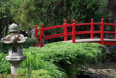 Red bridge in a public garden stock photo