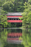 Red Bridge Reflection. George Hutchins Covered Bridge is reflected on a pond in Alley Park, south of Lancaster in Fairfield County, Ohio Stock Photography