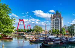 Red Bridge. Roterdam - The Netherlands - MAY, 3, 2014: Red Bridge in the background of an small sailing boat dock Royalty Free Stock Images