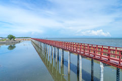 Red Bridge in The Sea. Red Bridge and Reflect Shadow in The Sea with Clear Blue Sky Stock Image