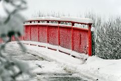 Red bridge in the snow. Red bridge in a snowy forest Stock Photography