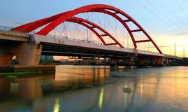 Red bridge. Stream flow in Saigon Royalty Free Stock Image