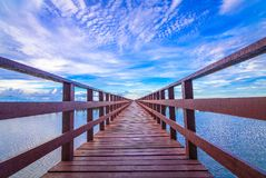 The red bridge and sun up or sun set on horizon. royalty free stock image