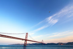 Red bridge at the sunset, Lisbon, Portugal Stock Images