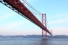 Red bridge at sunset, Lisbon, Portugal. Stock Photography
