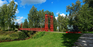 Red bridge. Red suspension bridge. cables keep the dragons Royalty Free Stock Photo