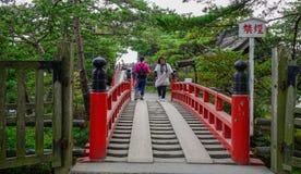 Red bridge to temple in Matsushima, Japan royalty free stock photos