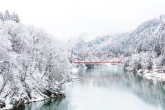 Red bridge winter landscape Stock Image