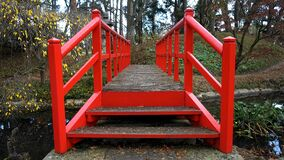 Red bridge in woods Royalty Free Stock Photography