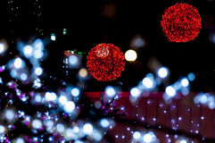 Red bright balls with white foreground lights. Christmas light balls and lights around them Royalty Free Stock Photos
