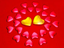 Red and bright  gold hearts Royalty Free Stock Photos