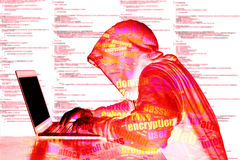 Red bright hooded wordcloud hacker with computer code. Red hooded hacker in front of computer code typing on laptop cybersecurity concept royalty free stock photography