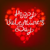 A red brilliant glowing heart. The inscription is the lettering of the happy Valentine s Day. Vector illustration. A red brilliant glowing heart. The Stock Image