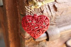 Red brilliant  heart as christmas decoration hanging from home d Royalty Free Stock Images