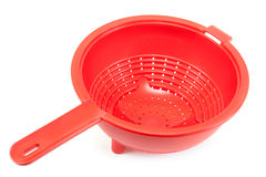 Red brilliant plastic colander Stock Photos